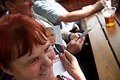 LOMZA, POLAND, JUNE 15, 2010:.Jaroslaw Kaczynski on the campaign trail:.Supporter Krystyna Swiecka with J.Kaczynksi leaflet during rally on the main square Lomza, north east Poland. .(Photo by Piotr Malecki / Napo Images)..LOMZA, 15/06/2010:.Zwolenniczka Kaczynskiego Krystyna Swiecka trzyma jego ulotke podczas spotkania wyborczego..Jaroslaw Kaczynski. Spotkanie z wyborcami..Fot: Piotr Malecki / Napo Images.