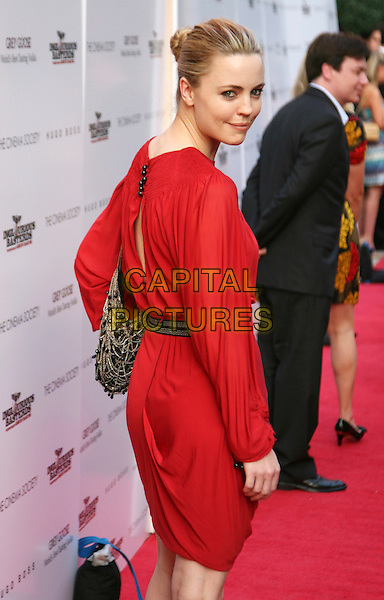 "MELISSA GEORGE .New York Screening of ""Inglourious Basterds"" held at the SVA Theatre, New York, NY, USA, .August 17th 2009..half length red dress long sleeved back over shoulder looking .CAP/LNC/TOM.©LNC/Capital Pictures."