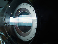 The Spanish coast is reflected in the glass of a porthole