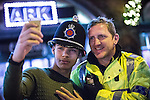 """© Joel Goodman - 07973 332324 . 19/12/2015 . Manchester , UK . A man poses for a selfie with a police constable whilst wearing his helmet . Revellers in Manchester enjoy """" Mad Friday """" - also known as """" Black Eye Friday """" - the day on which emergency services in Britain are typically at their busiest , as people head out for parties and drinks to celebrate Christmas . Photo credit : Joel Goodman"""