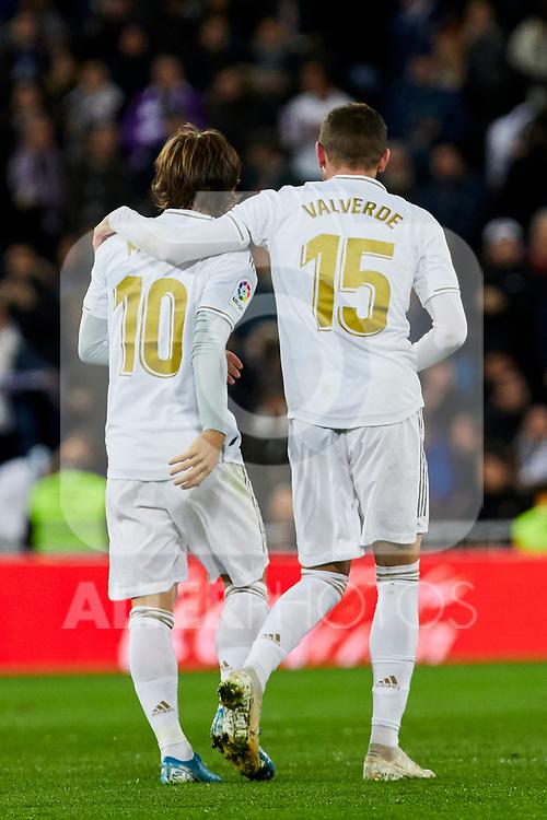 Luka Modric (L) and Fede Valverde (R) of Real Madrid celebrate goal during La Liga match between Real Madrid and Real Sociedad at Santiago Bernabeu Stadium in Madrid, Spain. November 23, 2019. (ALTERPHOTOS/A. Perez Meca)