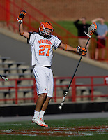 Ken Clausen (27) of Virginia celebrates a goal during the ACC men's lacrosse tournament semifinals in College Park, MD.  Virginia defeated Duke, 16-12.
