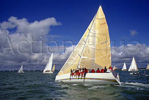 August 1994: The racing yacht 'Essex Girl' racing in the CHS class during Cowes Week Photo: Steve Bardens/actionplus...9408 sailing yachting boat boats sail sea water cloudy clouds sun sunshine stock one 50Mb