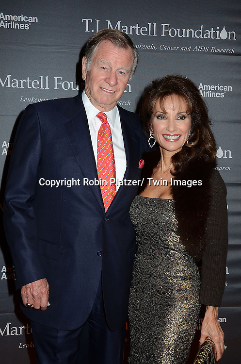 Helmet Huber and wife Susan Lucci in Alice and Olivia gold dress attends The 37th Annual TJ Martell Foundation Honors Gala on October 23, 2012 at Cipriani 42nd Street in New York City. The foundation is for Leukemia, Cancer and AIDS Reserarch.
