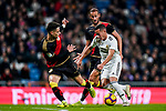 Lucas Vazquez of Real Madrid (R) competes for the ball with Alexandre Moreno Lopera, Alex Moreno, of Rayo Vallecano during the La Liga 2018-19 match between Real Madrid and Rayo Vallencano at Estadio Santiago Bernabeu on December 15 2018 in Madrid, Spain. Photo by Diego Souto / Power Sport Images