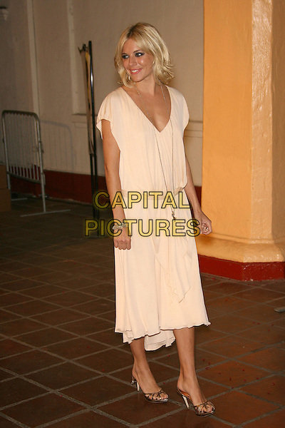 "SIENNA MILLER.SBIFF Opening Night - ""Factory Girl"" Premiere held at Arlington Theatre, Santa Barbara, California, USA..January 25th, 2007.full length white cream dress gold shoes necklace low waist drop satin belt.CAP/ADM/ZL.©Zach Lipp/AdMedia/Capital Pictures"