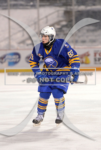 Buffalo Junior Sabres forward Pat Egan (93) during a game against the St. Michaels Buzzers at the Frozen Frontier outdoor game at Frontier Field on December 15, 2013 in Rochester, New York.  St. Michael's defeated Buffalo 5-4.  (Copyright Mike Janes Photography)