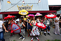 Members of the Baby Doll Sisterhood second line in memory of Baby Doll Tee Eva Perry, who died at 83 on June 7, in New Orleans, La. Monday, June 11, 2018. <br /> <br /> Members of the Baby Dolls Sisterhood dance for Baby Doll Tee Eva Perry, who died at 83 on June 7, in front of Tee-Eva's Authentic New Orleans Pralines on Magazine Street in New Orleans, La. Monday, June 11, 2018. Those dancing include Ja&Otilde;Niya 'G-Baby Doll' Dabney, 9, left, Lyndee 'Baby Doll Pinky' Harris, 8, Black Storyville Baby Dolls Joell Lee and Dianne Honore who are friends and family of Perry.ADVOCATE Caption