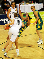Tall Ferns forward Lisa Wallbutton knocks Rohanee Cox out of her way during the International women's basketball match between NZ Tall Ferns and Australian Opals at Te Rauparaha Stadium, Porirua, Wellington, New Zealand on Monday 31 August 2009. Photo: Dave Lintott / lintottphoto.co.nz