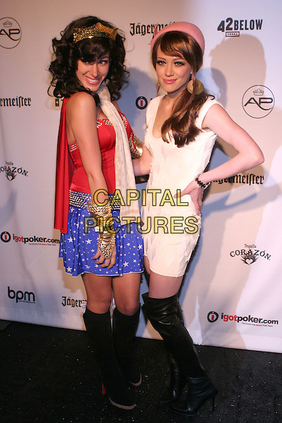 HAYLIE DUFF & HILARY DUFF.The AirParty Hollywood Halloween Benefit for the Trevor Project held at Henson Studios, Hollywood, California..October 30th, 2005.Photo: Zach Lipp/AdMedia/Capital Pictures.Ref: ZL/ADM.full length costume dress up Wonder Woman red blue skirt black boots white dress pink hat crown sisters siblings hand on hip.www.capitalpictures.com.sales@capitalpictures.com.© Capital Pictures.