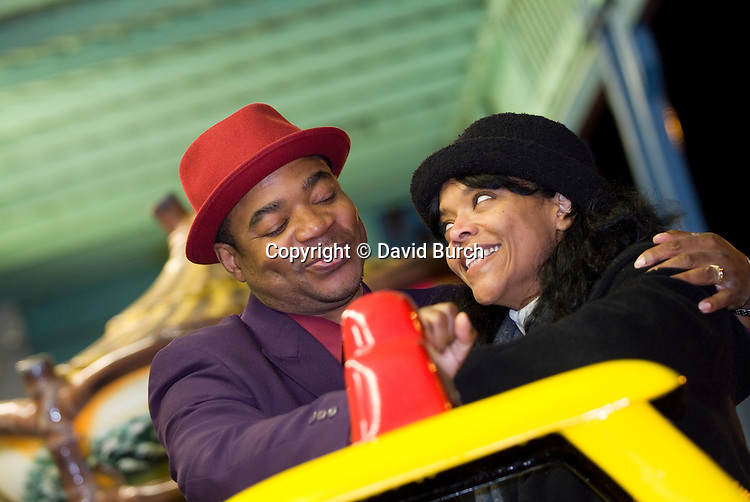 African American couple at carnival, smiling