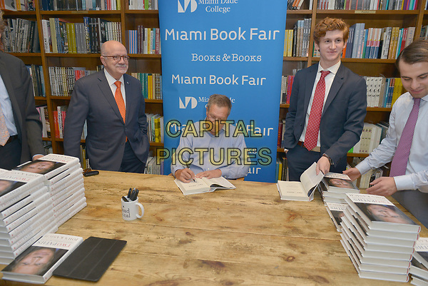 CORAL GABLES, FL - MAY 26: John Kasich (C), Governor of Ohio and a former U.S. presidential candidate pose for picture with Eduardo J. Padr&Ucirc;n(L), President, Miami Dade College during Governor Kasich book signing 'Two Paths: America Divided or United' at Books and Books on May 26, 2017 in Coral Gables, Florida. <br /> CAP/MPI10<br /> &copy;MPI10/Capital Pictures