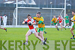 Michael O'Riordan Rathmore is tackled by PJ Murphy Gneeveguilla during their O'Donoghue cup semi final in Fitzgerald Stadium on Sunday