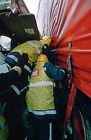 Firefighters climbing between two lorries that have crashed together to try and reach trapped driver...© SHOUT. THIS PICTURE MUST ONLY BE USED TO ILLUSTRATE THE EMERGENCY SERVICES IN A POSITIVE MANNER. CONTACT JOHN CALLAN. Exact date unknown.john@shoutpictures.com.www.shoutpictures.com...
