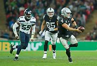 Oakland Raiders Quarterback Derek Carr (4) fakes a pass