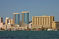Dubai, United Arab Emirates. Dubai Creek and commercial waterfront offices, hotels, etc. Twin Towers and InterContinental Hotel and Plaza.