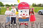 Donal Daly, Darragh Sweeney and Nicole Walker with Lee Strand's Mighty Mikey enjoying the Ted O'Keeffe Family Fun Day at Ballymac GAA on Sunday