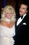 Loni Anderson and Burt Reynolds attend aHollywood Premiere on December 1, 1984 in Hollywood, California.