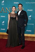 "HOLLYWOOD, CA - FEBRUARY 13: Caitriona Balfe, Sam Heughan, at the Premiere Of Starz's ""Outlander"" Season 5 at HHollywood Palladium in Hollywood California on February 13, 2020. Credit: Faye Sadou/MediaPunch"