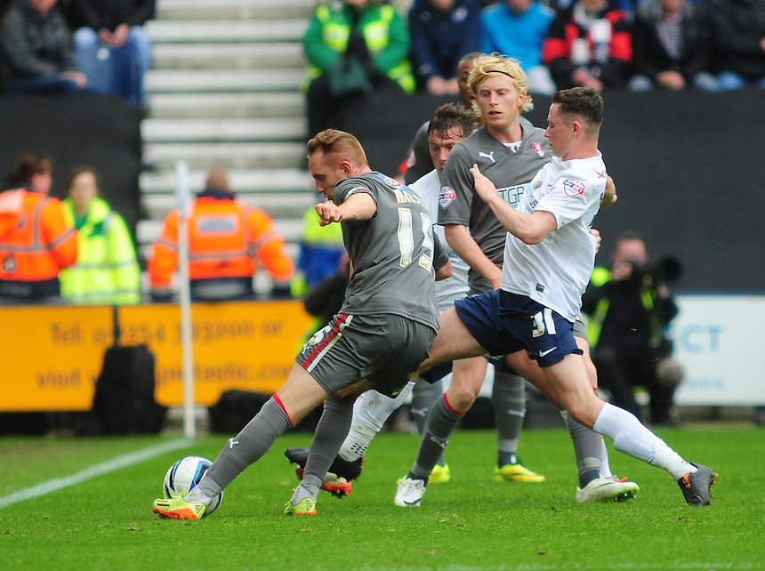 Rotherham United's Robert Milsom is tackled by Preston North End's Alan Browne <br /> <br /> Photographer Chris Vaughan/CameraSport<br /> <br /> Football - The Football League Sky Bet League One Play-Off First Leg - Preston North End v Rotherham United - Saturday 10th May 2014 - Deepdale - Preston<br /> <br /> &copy; CameraSport - 43 Linden Ave. Countesthorpe. Leicester. England. LE8 5PG - Tel: +44 (0) 116 277 4147 - admin@camerasport.com - www.camerasport.com