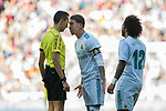 Sergio Ramos (C) of Real Madrid speaks with referee Jose Maria Sanchez Martinez (L) during the La Liga 2017-18 match between Real Madrid and FC Barcelona at Santiago Bernabeu Stadium on December 23 2017 in Madrid, Spain. Photo by Diego Gonzalez / Power Sport Images