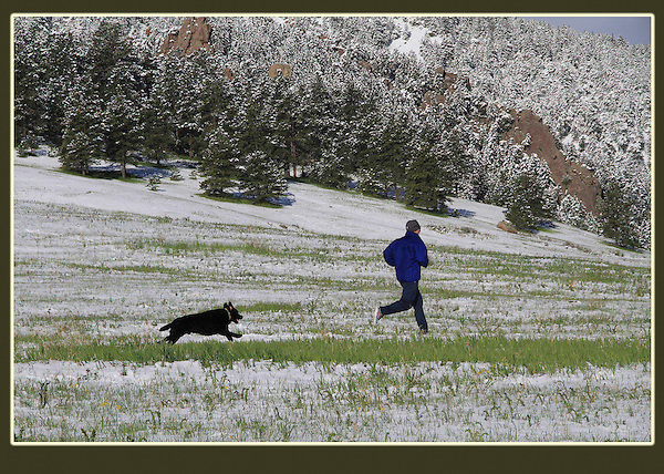 Photoshop. Runner and dog added. <br /> Here, a man and its owner enjoy a run soon after a spring snowstorm.