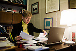 March 17, 2009. Raleigh, NC.. Images from one day in the life of Deborah K. Ross, Representative for North Carolina House District 38.. 9:08 AM. Ross starts her day by reviewing upcoming bills and answering email. She does not go to legislature related breakfasts so as that she can exercise and spend time with her dog and husband.