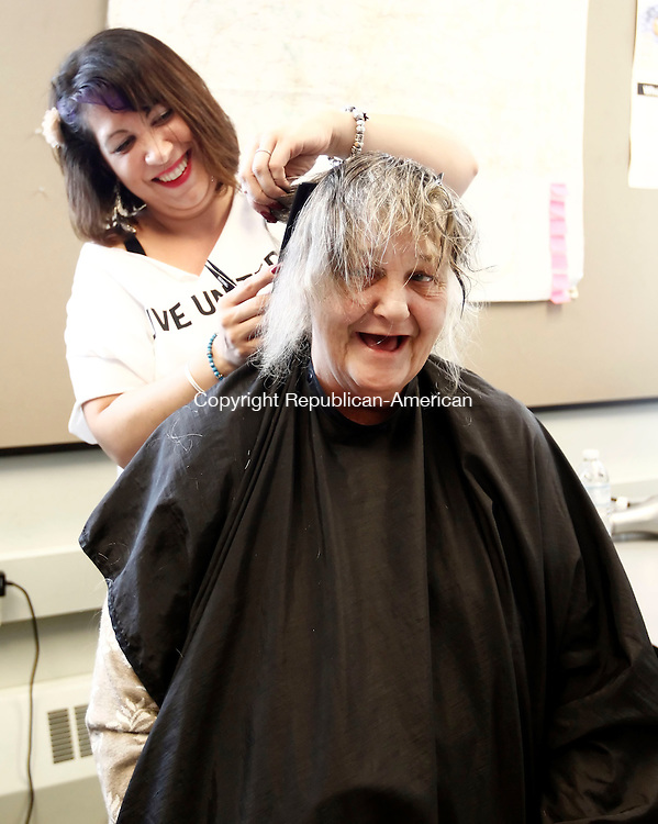 Waterbury, CT- 18 October 2013-101813CM04- Mary Jones of Waterbury has her hair cut by Christy Notaro, a student at the Paul Mitchell School in Danbury, during the United Ways annual Project Homeless Connect at the Waterbury Armory Friday afternoon.  The event provides medical services and resources to area homeless and those less fortunate.   Christopher Massa Republican-American
