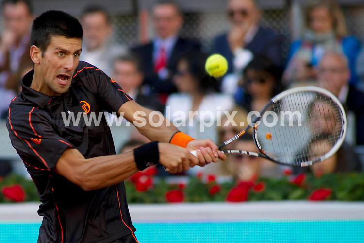 **ALL ROUND PICTURES FROM SOLARPIX.COM**                                             **WORLDWIDE SYNDICATION RIGHTS EXCEPT SPAIN - NO SYNDICATION IN SPAIN**                                                                                  Caption: The Mens 2011 Madrid Open tennis final between Novac Djocovic and Rafael - Rafa - Nadal. Madrid, Spain. 8 May 2011                                                                              This pic: Novac Djocovic                                                                           JOB REF: 13303 DMS Drake      DATE: 08_05_2011                                                           **MUST CREDIT SOLARPIX.COM OR DOUBLE FEE WILL BE CHARGED**                                                                      **MUST AGREE FEE BEFORE ONLINE USAGE**                               **CALL US ON: +34 952 811 768 or LOW RATE FROM UK 0844 617 7637**