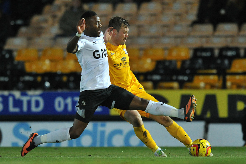 Preston North End's Scott Laird and Port Vale's Jennison Myrie-Williams battle for the ball<br /> <br /> Photo by Dave Howarth/CameraSport<br /> <br /> Football - The Football League Sky Bet League One - Port Vale v Preston North End - Tuesday 26th November 2013 - Vale Park - Burslem<br /> <br /> &copy; CameraSport - 43 Linden Ave. Countesthorpe. Leicester. England. LE8 5PG - Tel: +44 (0) 116 277 4147 - admin@camerasport.com - www.camerasport.com