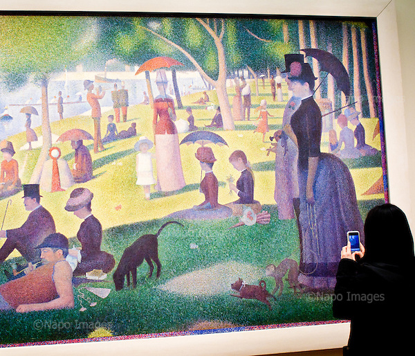 "CHICAGO, ILLINOIS, USA 29 APRIL, 2012:.Muslim woman and a paiting ""A Sunday Afternoon on the Island of La Grande Jatte"" by Georges Seurat, at the Art Institute of Chicago.(Photo by Piotr Malecki / Napo Images)..CHICAGO, ILLINOIS, USA 29/04,2012:.Muzulmanka i obraz ""Niedzielne popoludnie na wyspie La Grande Jatte"" Geaorge'a Seurata, w Art Institute of Chicago..Fot: Piotr Malecki / Napo Images"