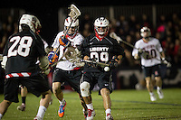 Liberty Flames Men's Lacrosse team plays NC State University at the lacrosse fields for the annual Blackout Game on March 28, 2014. (Photo by Kevin Manguiob)