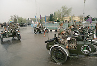 Soldiers of warlord Ahmad Shah Massoud arm on sidecar on the road to the military parade, for the celebration of the Kabul liberation from the communist.