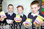 GRUB'S UP: Chloe O'Halloran, Shauna Dineen and Aidan Lane enjoying the ChildLine breakfast at Rathmorrel national school in Causeway on Friday.