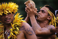 Marquesan man blows pu (conch shell) welcoming arrival of canoes at Taiohae, Nuku Hiva, Marquesas Islands in the South Pacific.<br />