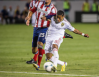 CARSON, CA - May 19, 2012: Real Salt Lake forward Joao Plata (8) makes his goal kick during the Chivas USA vs Real Salt Lake match at the Home Depot Center in Carson, California. Final score, Chivas USA 1, Real Salt Lake 4.