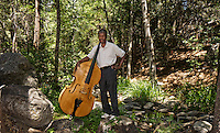 Marshall Hawkins with his bass in Strawberry Creek at the intersection of North and South Circle Drives, Idyllwild