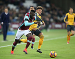 West Ham's Arthur Masuaku tussles with Arsenal's Alex Oxlade-Chamberlain during the Premier League match at the London Stadium, London. Picture date December 3rd, 2016 Pic David Klein/Sportimage