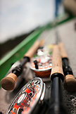 BRAZIL, Agua Boa, fishing rods and reels laying in a boat, Agua Boa River and resort