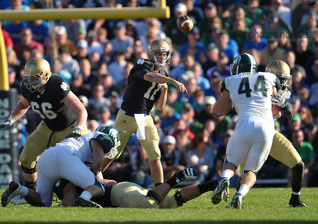 Sept. 17, 201; Quarterback Tommy Rees (11) throws against Michigan State...Photo by Matt Cashore
