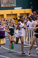 Lincoln's Twishana Williams, Missouri Southern's Rachel Schrader, and Truman State's Anne Ratterman, chase Emporia State's Katie Mona in the Mile Final Section 2 at the 2012 MIAA Indoor Track & Field Championships at Missouri Southern in Joplin, February 26.