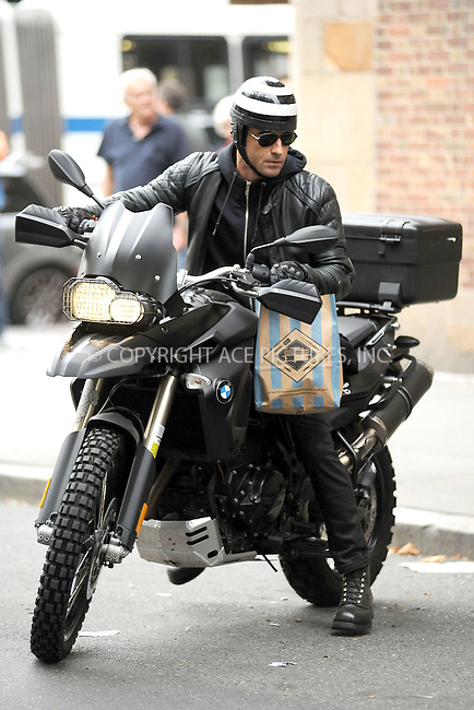 WWW.ACEPIXS.COM . . . . . .September 17, 2011...New York City....Justin Theroux on his BMW motorcycle on September 17, 2011 in New York City. .....Please byline: KRISTIN CALLAHAN - ACEPIXS.COM.. . . . . . ..Ace Pictures, Inc: ..tel: (212) 243 8787 or (646) 769 0430..e-mail: info@acepixs.com..web: http://www.acepixs.com .