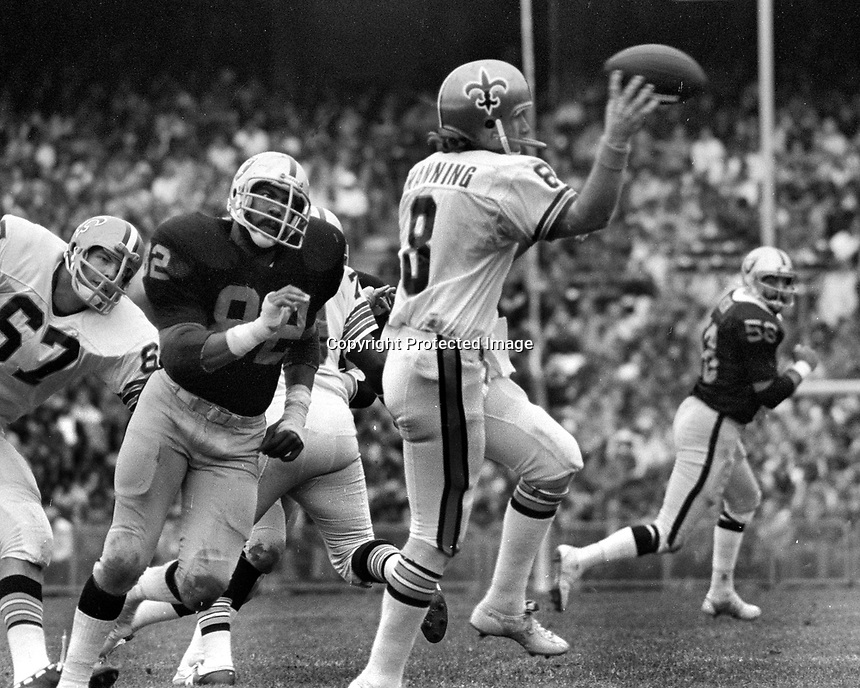 Raiders Horace Jones rushs the New Orleans Saints QB Archie Manning..(1975 photo/Ron Riesterer)