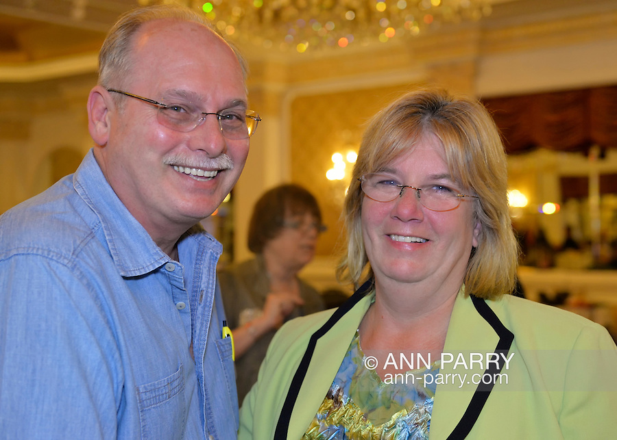 Garden City, New York, USA. 3rd November 2015. R-L, Democrat CLAUDIA BORECKY and husband MICHAEL BORECKY, from Merrick, attend Election Night Party of the Nassau County Democrats, at the Garden City Hotel. Borecky was the Democratic candidate for Nassau County Legislative District 19.