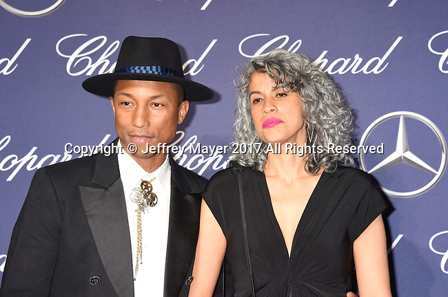 PALM SPRINGS, CA - JANUARY 02: Producers Pharrell Williams (L) and Mimi Valdes attend the 28th Annual Palm Springs International Film Festival Film Awards Gala at the Palm Springs Convention Center on January 2, 2017 in Palm Springs, California.