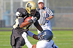 Palos Verdes CA 10/22/10 - Devin Christy (Leuzinger #5) and Okuoma Idah (Peninsula #24) in action during the Leuzinger - Peninsula varsity football game at Palos Verdes Peninsula High School.