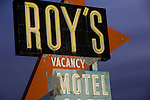 A closeup of the historic Roy's Motel and Cafe sign, a landmark located along historic Route 66 at Amboy, California, as seen on a moonlit night.