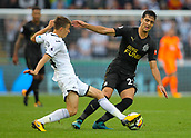 10th September 2017, Liberty Stadium, Swansea, Wales; EPL Premier League football, Swansea versus Newcastle United; Mikel Merino of Newcastle United is tackled by Tom Carroll of Swansea City