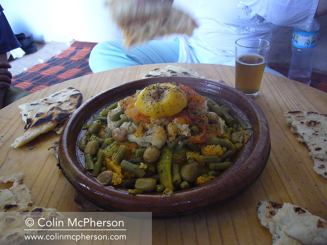 A traditional Berber tajine meal being served to tourists at a village in the Atlas mountains near Taroudant in southern Morocco. Berbers were the indigenous peoples of North Africa west of the Nile Valley and speak various Berber languages, which together form a branch of the Afroasiatic language family. Between 14 and 25 million Berber speakers live within this region, most densely in Morocco and becoming generally scarcer eastward through the rest of the Maghreb and beyond.