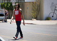 Jun. 10, 2013; Phoenix, AZ, USA: Phoenix Mercury center Brittney Griner walks to the Golden Rule Tattoo shop in downtown Phoenix. Mandatory Credit: Mark J. Rebilas-